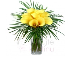 Bouquet of yellow callas and greenery